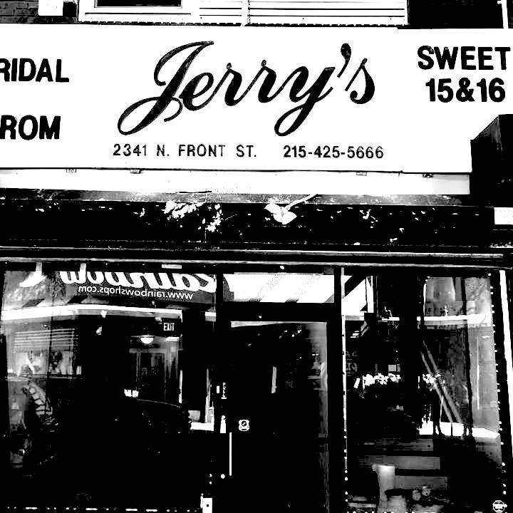 high contrast photo of Jerry's on Front storefront window as viewed from the sidewalk